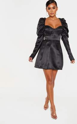 PrettyLittleThing Black Bonded Satin Cup Detail Puff Sleeve Skater Dress
