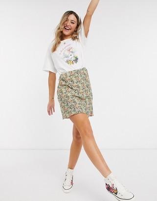 Asos DESIGN mini bias slip skirt in ditsy floral print