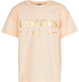 River Island Girls pink 'Famous' mesh oversized T-shirt