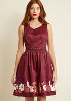 B3586F Though your tastes may change with the seasons, this deep red A-line is a piece you're thrilled to flaunt all year 'round. Part of our ModCloth namesake label, this perfect-fit midi features pockets and a pumpkin-filled border print, radiating