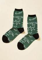 These dark green socks inspire after-hours innovation. Designed with black trim and white mathematical equations, this geek chic pair is the solution to chilly toes!