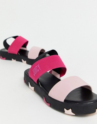 Juicy Couture sandals with star sole in pink and black
