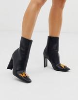 Asos Design DESIGN Ellis metal trim ankle boots in black