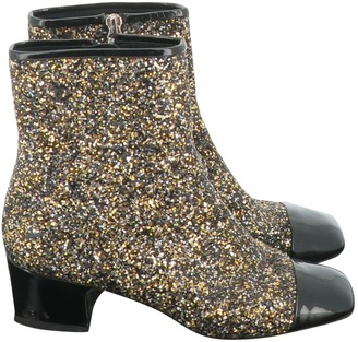 Chanel Gold Glitter Ankle boots