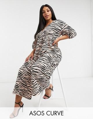 ASOS DESIGN Curve jersey wrap smock textured jumpsuit in animal print