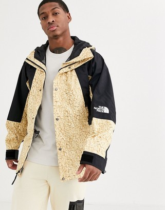 The North Face 94 Retro Mountain Light jacket in white sherpa print