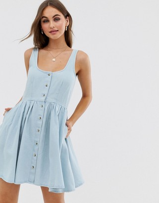 Asos Design DESIGN denim scoop neck button front skater mini dress in lightwash blue