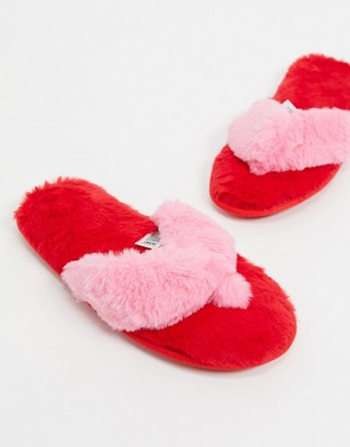 ASOS DESIGN Ziva faux fur flip flop slippers in red and pink