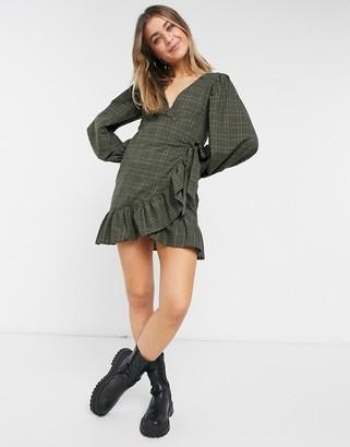 ASOS DESIGN wrap front mini dress with pephem in khaki check