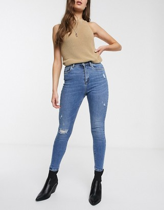 Only distressed skinny jeans in blue