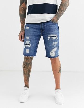 Levi's 511 slim fit low rise cutoff distressed denim shorts in hendersonville mid vintage wash-Blue
