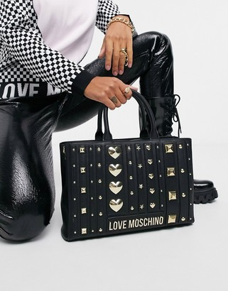 Love Moschino love and more studded top handle bag in black