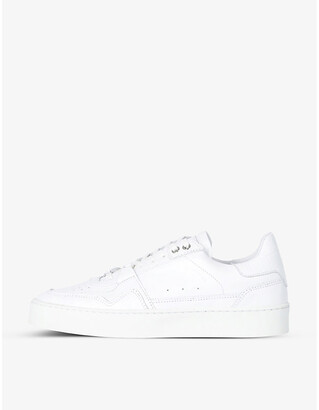 The Kooples Perforated leather low-top trainers