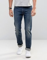 Lacoste Jeans In Slim Fit Mid Wash