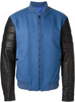 Versace contrasted sleeve bomber jacket - men - Wool/Polyimide/Lamb Skin/Polyester - 52