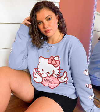 New Girl Order Curve x Hello Kitty oversized sweatshirt in baby blue with angel kitty graphics