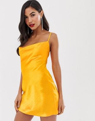 Asos Design DESIGN cami mini slip dress in high shine satin with lace up back-Orange
