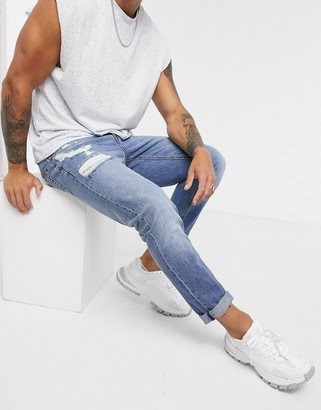 ASOS DESIGN slim jeans in mid wash with abrasions