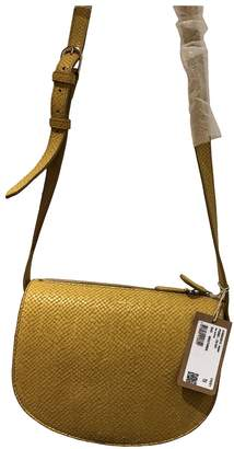 A.P.C. Yellow Crocodile Handbags