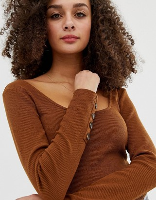 Asos Design DESIGN crop top with scoop neck and long sleeve with buttons-Brown