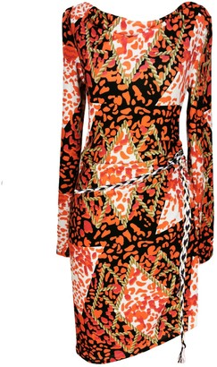 Jersey printed dress orange with decorative binding