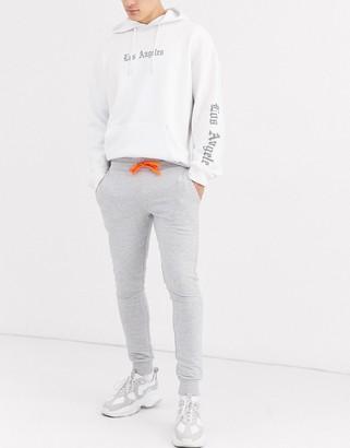 Asos Design DESIGN super skinny joggers in grey marl with neon orange drawcords