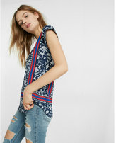 Express floral print and placed stripe zip front blouse