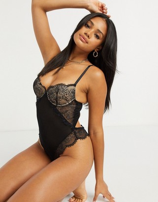 We Are We Wear delicate lace lightly padded bodysuit with open strappy back detail in black and pink