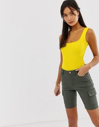 New Look scoop back body in yellow