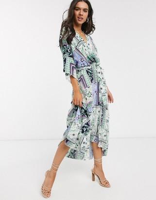 Liquorish wrap front maxi dress with hi-low hem in patchwork floral print