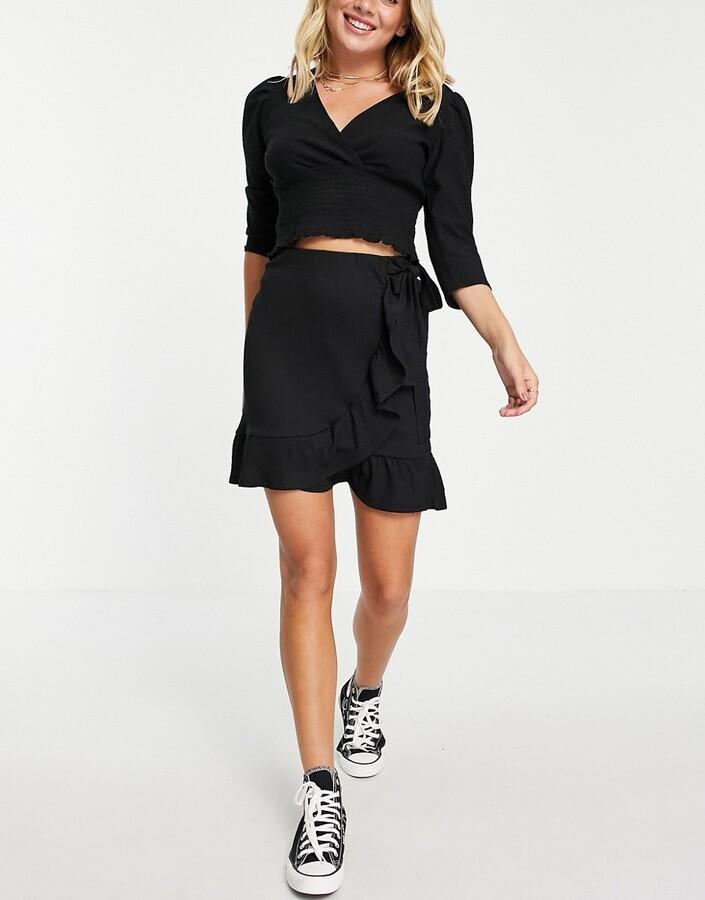 New Look tie side wrap mini skirt in black