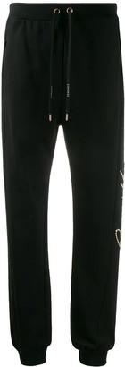 Versace studded Gianni track pants