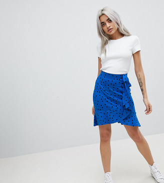 Asos DESIGN Petite mini wrap skirt in polka dot print