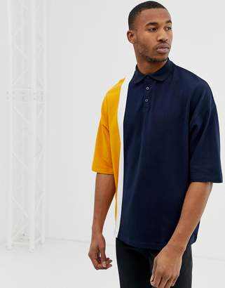 Asos DESIGN oversized polo shirt in pique fabric with vertical color block in navy