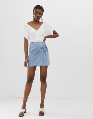 Asos DESIGN soft denim wrap mini skirt in lightwash blue