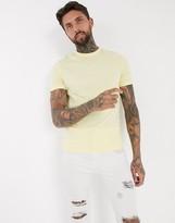 Asos Design ASOS DESIGN t-shirt with acid wash in yellow