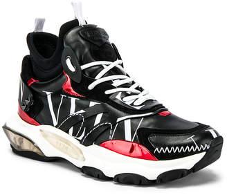Valentino Hi-Top Logo Sneaker in Black | FWRD