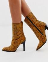 Asos Design DESIGN Evolution leather high ankle boots in yellow snake