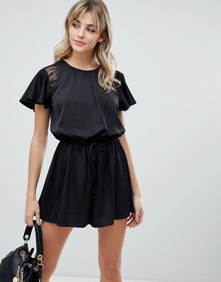 ASOS DESIGN flutter sleeve lace insert open back playsuit