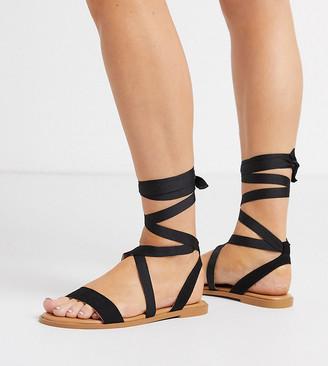 ASOS DESIGN Wide Fit Finland tie leg flat sandals in black