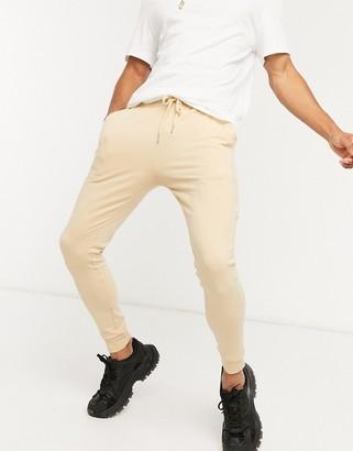 ASOS DESIGN co-ord lightweight super skinny jogger in beige