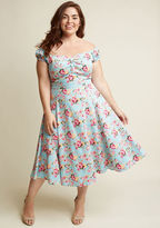 VSS170811B You're pleased as punch over this off-the-shoulder dress and you want to party about it! Style the sky blue hue - printed with pink-and-peach florals, scallops, and lanterns - neckline pleating, and decorative buttons of this cotton midi from Collec