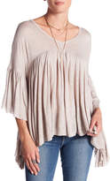 Anama Allover Ruffle Asymmetrical Hem Blouse