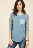 1259GO1 If life's busy tendencies have you feeling a bit off-track, this raglan tee will turn things right around. The moment its heathered knit hits your frame, you'll feel a bit more at ease - not to mention the blue, grey, and mint colorblocks of this pocketed
