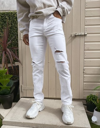 ASOS DESIGN stretch tapered jeans in white with rips