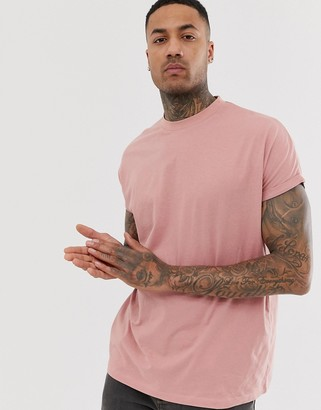 Asos Design DESIGN oversized longline t-shirt with crew neck and roll sleeve in pink