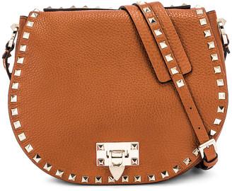Valentino Small Rockstud Saddle Bag in Selleria | FWRD