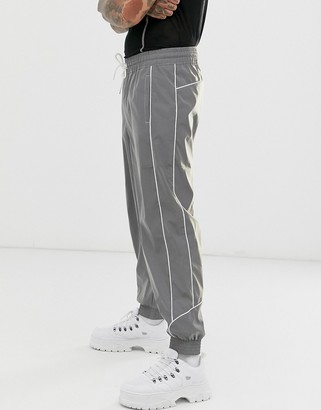 ASOS DESIGN oversized tapered joggers in reflective fabric with piping