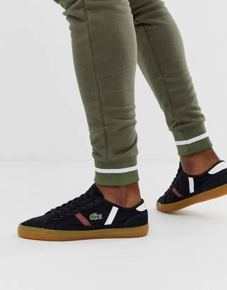 Lacoste Sideline sneakers with gum sole in black canvas