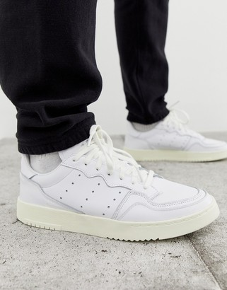 adidas SuperCourt trainers in white x home of classics edition